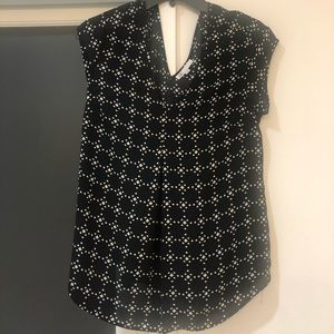 Woman's black and white blouse